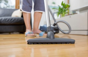 Woman Vacuuming Markham Real Estate Blog